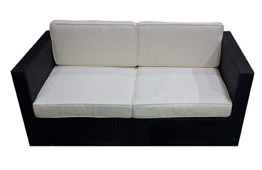 Rattan sofa with white cushions great for outdoor and themed events