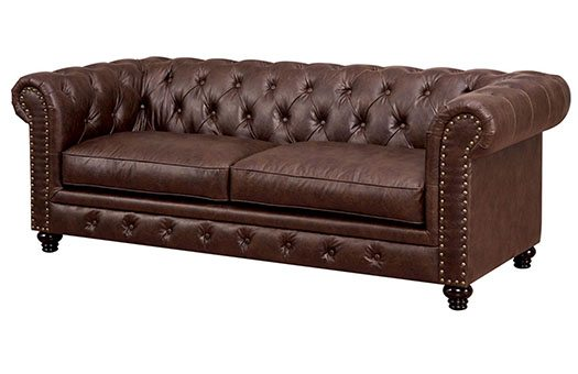 Brown leather sofa with rolled arms and tufted back great for galas and more