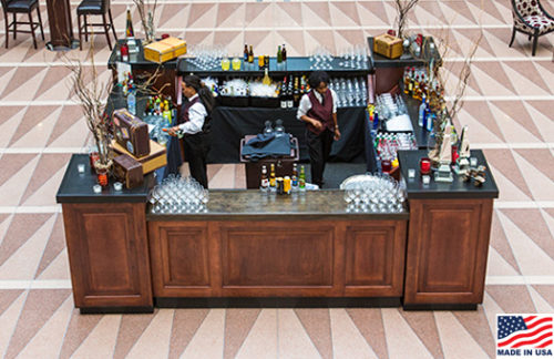 8 foot Mahogany bar fronts with ebony countertop and mahogany pedestals in a square configuration great for special events